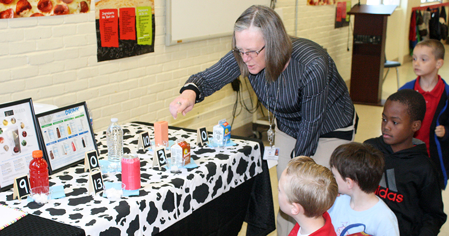 Healthy Kids Day - Shannon Landry showing students sugar in beverages