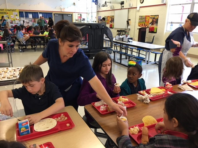 Healthy Kids Day - Students taste testing Mexican beans