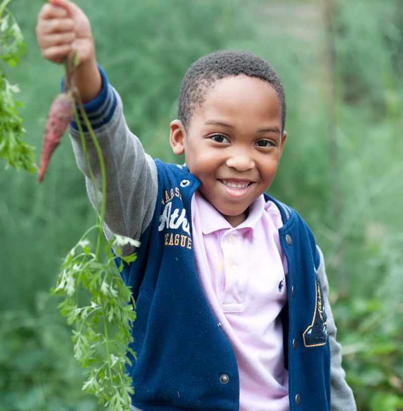2019 USDA Farm to School Census Photo of a Boy in a Garden