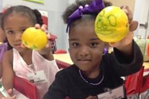 Jutland Head Start Students Showing Their Decorated Satsumas