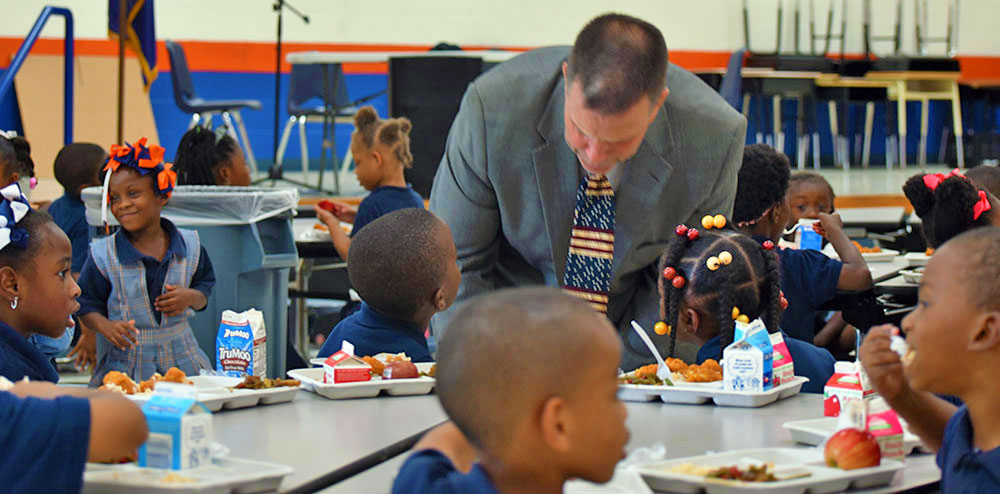 John Dupre, Director of Nutrition Support for the Louisiana Department of Education, Visiting with Students in a Cafeteria