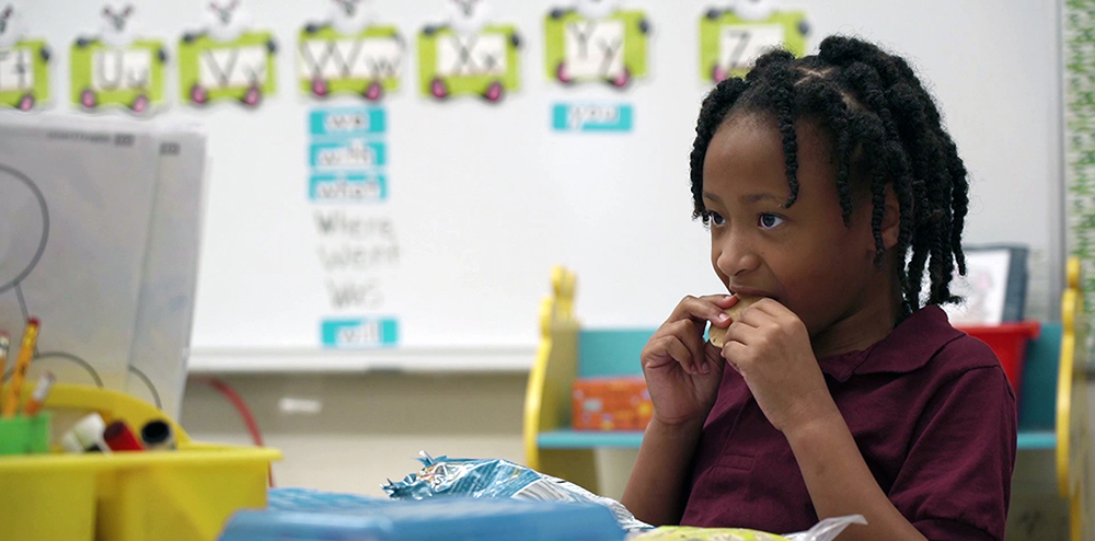 Twin Oaks Elementary Student Eating Breakfast